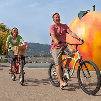 Couple Biking by the Penticton Peach