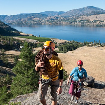 Couple rock climbing in Penticton