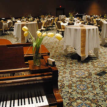 Reception set up with high tops and piano